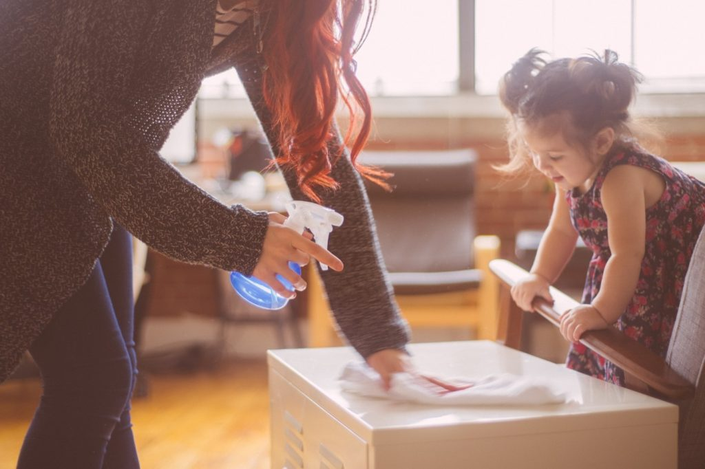 small girl helping her mother pack a box