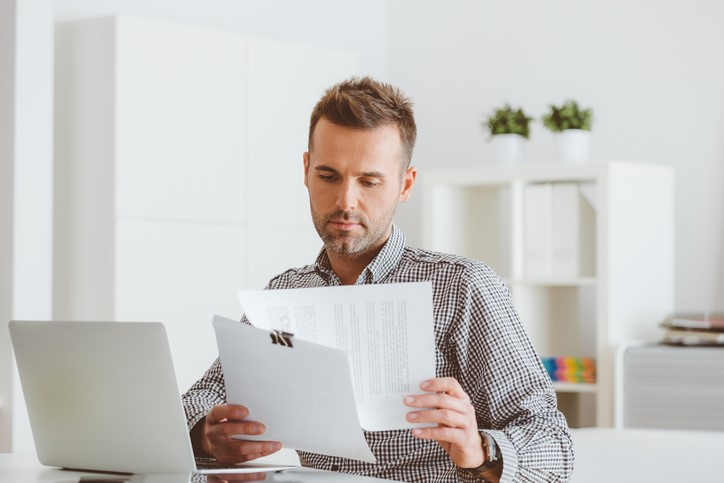 man looking over his address details