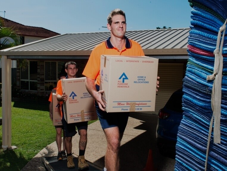 men carrying out all purpose removals' boxes
